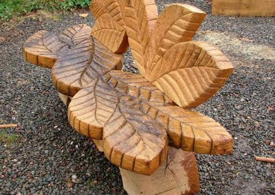 Susheila Jamieson, Leaf Seat, Oak, 1800 x 450 x 900mm. One of two seats created for the North Penine Cycle Way for Sustrans. Designs developed with youth groups in Wooler and Etal.