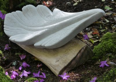 Susheila Jamieson, Feather V, Portland limestone and oak, 550 x 300 x 180mm.